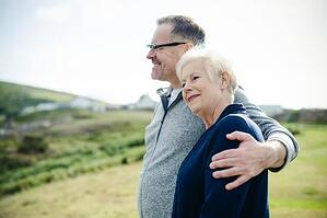 CCRCs Versus Independent Living Determining Your Best Over-55 Community Option — Senior couple overlooking landscape while enjoying retirement in Federal Way