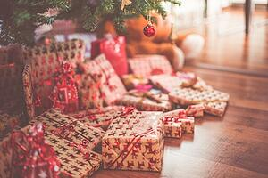 Elegantly wrapped presents beneath decorated Christmas tree