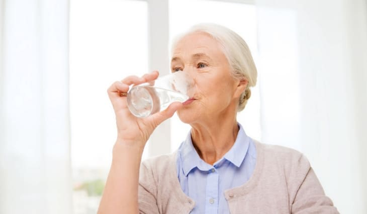 Elderly Woman Drinking a Glass of Water to Stay Hydrated in Federal Way, Washington