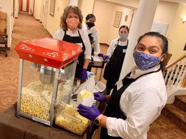 Village Green Staff Just Poppin' By to Bring Popcorn to Independent and Assisted Living Residents in Federal Way